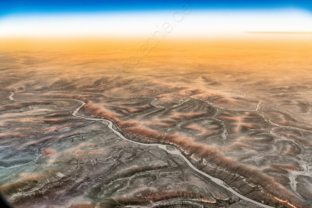 Sunset overflying Sibiria with seen shadow of earth, Russia